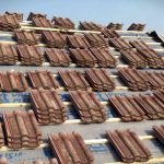 Tiles Stacked On Roof.